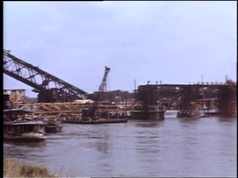 damaged bridge crossing river / rhine, germany - rhein stock-videos und b-roll-filmmaterial