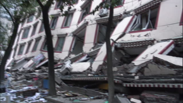 a damaged building sags into itself in the earthquake aftermath at sichuan china - earthquake stock videos & royalty-free footage