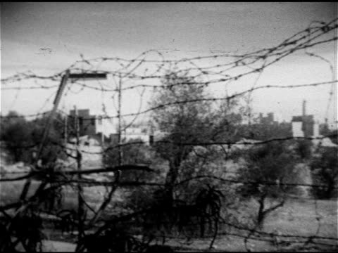 Damaged building still in state of disrepair from ArabIsrael war194849 PAN Barbed wire dividing Jerusalem into Arab 'Old City Israel 'New City' Arab...
