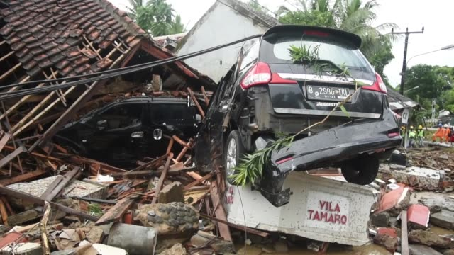damaged buildings and vehicles hit by tsunami are seen in banten province indonesia on december 24 2018 at a hotel resort the death toll from... - the lost tree stock videos and b-roll footage