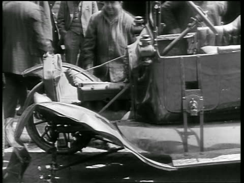 b/w 1919 damaged car after being hit by trolley / newsreel - newsreel stock videos and b-roll footage