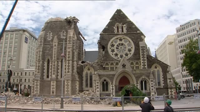 damaged christ church cathedral in christchurch with crane on grounds and destroyed tower. - earthquake stock videos & royalty-free footage