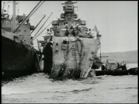 Damaged Destroyer next to ship barge water spraying out of hull WS Light Cruiser USS Honolulu w/ torpedo damage in Tulagi Harbor USS Saint Louis w/...