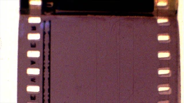stockvideo's en b-roll-footage met beschadigde film 4k - cameraman