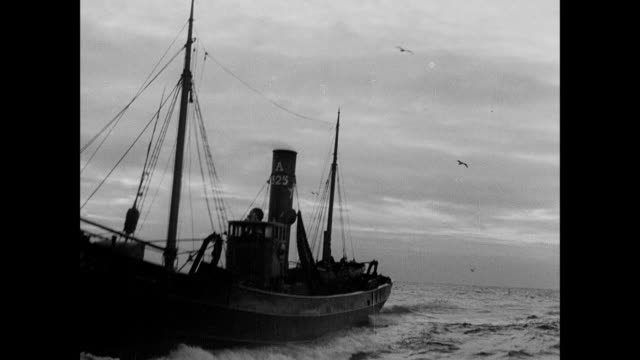 montage a damaged fishing trawler hails a ship so that it can be towed back to aberdeen / scotland, united kingdom - sailing stock videos & royalty-free footage