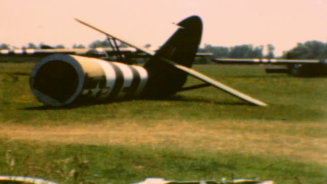 stockvideo's en b-roll-footage met damaged gliders of the 101st airborne division / hedgerows and fields near cherbourg / dday glider damage on june 06 1944 in hiesville france - zweefvliegtuig