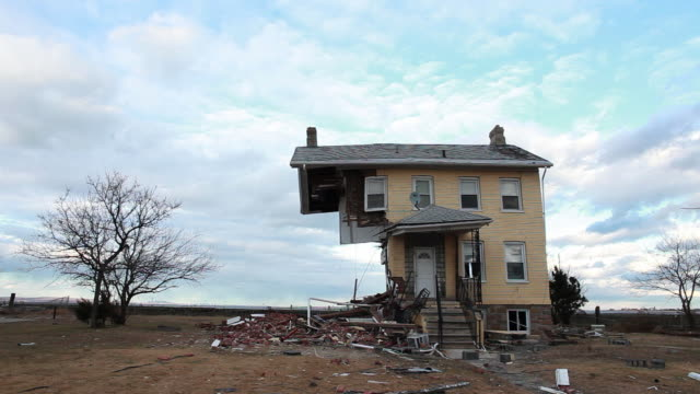 wide shot damaged historic house - princess cottage - after hurricane sandy.  the house - built in 1855 - is part of over 200 homes that were destroyed or damaged in union beach, new jersey area - hurrikan stock-videos und b-roll-filmmaterial