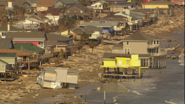 ws zo pan damaged houses on shoreline due to hurricane / gilchrist, texas, usa - damaged stock videos & royalty-free footage