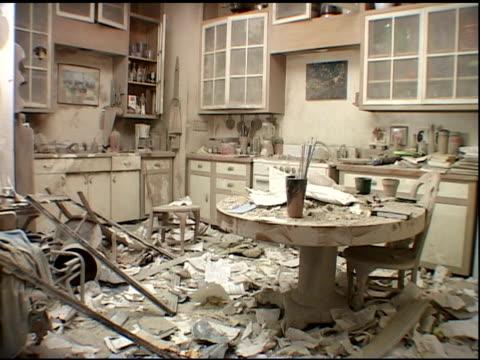 damaged kitchen in second ground zero apartment after the september 11, 2001 wtc terrorist attacks. kitchen table with rubble, dirt, debris on top. - 2001 bildbanksvideor och videomaterial från bakom kulisserna