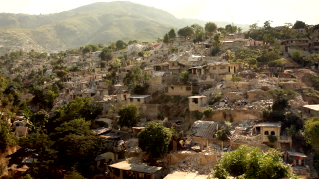 damaged landscape of collapsed buildings after the haiti earthquake of january 2010 - ポルトープランス点の映像素材/bロール