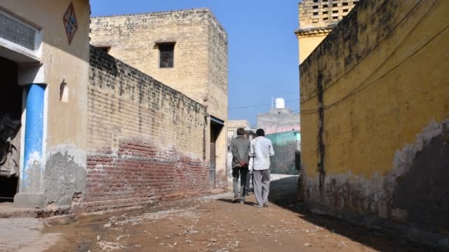 vídeos y material grabado en eventos de stock de a damaged lane is seen in dhamaka village haryana india on thursday jan 11 a man walks along a lane in dhamaka village men are seen walking along a... - haryana