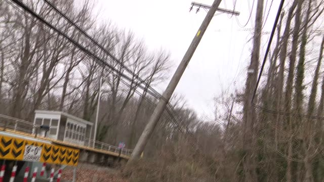 A damaged power line is blown over by nor'easter winds in NYC The line is pushed onto other cables next to train tracks