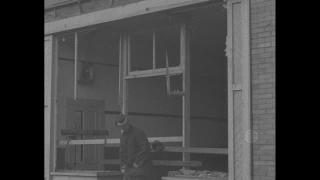 ext damaged roderick hotel headquarters of international workers of the world with people milling around / store window frames without windows / men... - 1910 1919 stock videos and b-roll footage