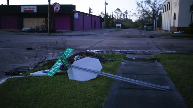 damaged street name sign after hurricane delta in lake charles. floodwaters are pictured after hurricane delta made landfall. delta churned toward... - street name sign stock videos & royalty-free footage