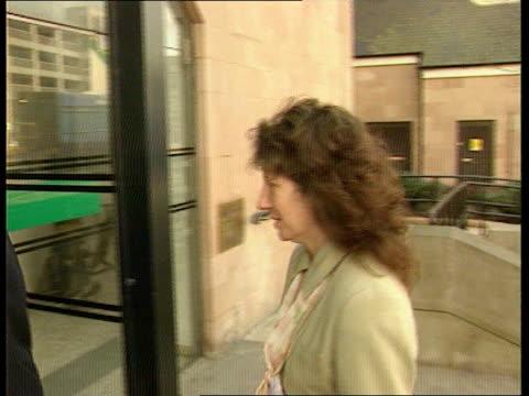 damages for victims of child abuser frank beck england nottingham high court ms debra barry man along pan rl as into court building jennifer... - ノッティンガム点の映像素材/bロール