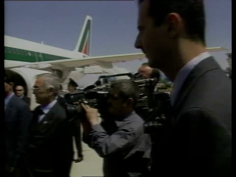 damascus ext pope john paul ii down steps of aircraft on arrival president assad waiting to greet the pope president assad greeting the pope pope... - pope john paul ii stock videos and b-roll footage