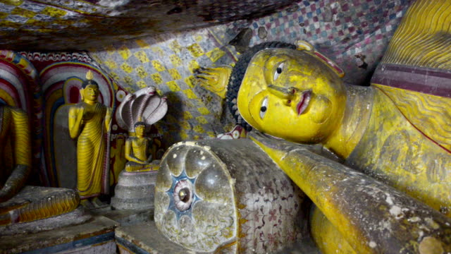 royal cave temple in dambulla, sri lanka - buddha stock-videos und b-roll-filmmaterial
