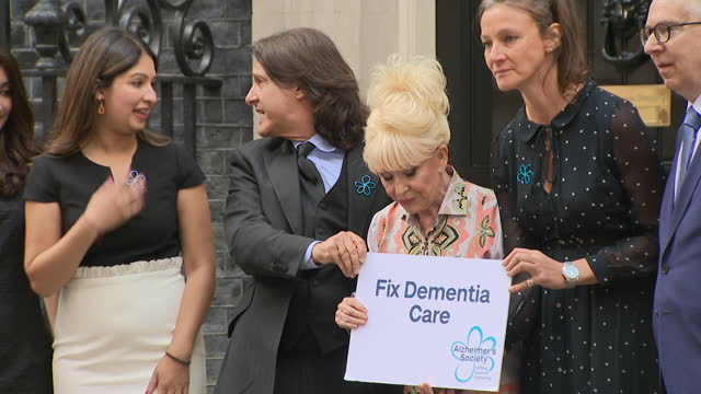 dame barbara windsor arriving at 10 downing street with husband scott mitchell, to present petition highlighting concerns over dementia care on... - focus concept stock videos & royalty-free footage