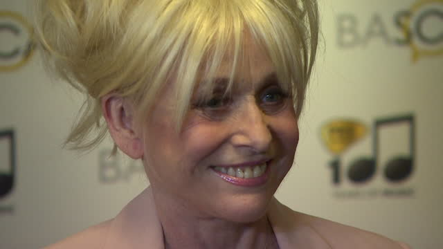 dame barbara windsor arriving at 2014 ivor novello awards with husband scott mitchell and then posing on red carpet for press - mental illness stock videos & royalty-free footage