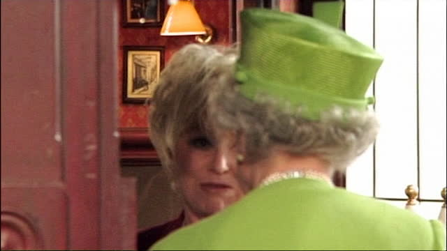 dame barbara windsor, dressed as peggy mitchell, shows the queen around the queen vic during her visit to the set of eastender - mental illness stock videos & royalty-free footage