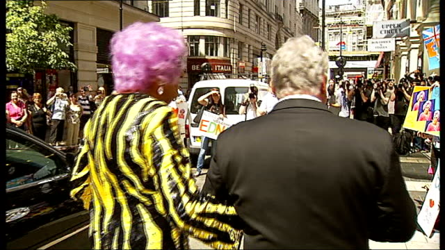 dame edna everage announces farewell uk tour england london london palladium ext dame edna everage out of car waving to crowd and saying 'hello... - gladiolus stock videos & royalty-free footage