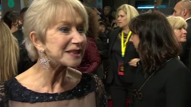 dame helen mirren reacts to being awarded the bafta fellowship by prince william during red carpet interview at the baftas 2014 - 2014 stock videos & royalty-free footage