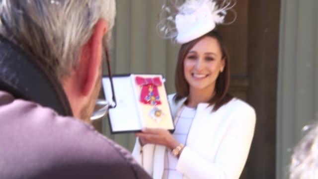 Interview ENGLAND London Buckingham Palace EXT David Beckham along outside Palace / Dame Jessica EnnisHill posing with award / Dame Jessica EnnisHill...