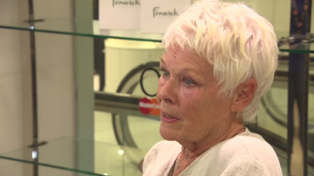 dame judi dench at shop with the stars at fenwick on april 10, 2014 in london, england. - judi dench stock videos & royalty-free footage
