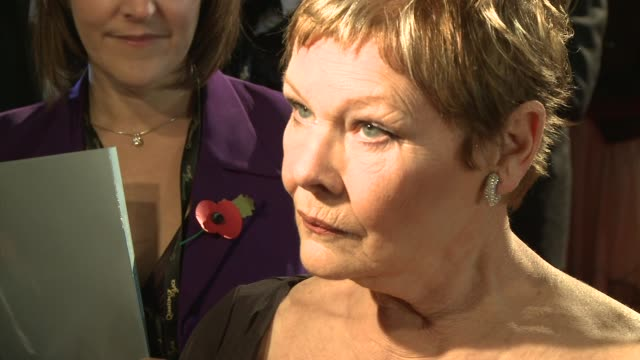 dame judi dench on the excitement of playing different rolls at the quantum of solace world premiere at london . - ジュディ・デンチ点の映像素材/bロール