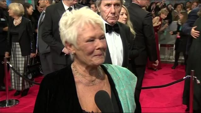 dame judi dench response to having a long history with bafta during red carpet interview at the baftas 2014 - 2014 stock videos & royalty-free footage