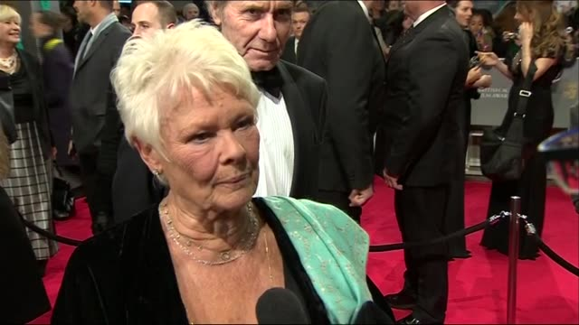 dame judi dench speaks about portraying philomena lee during red carpet interview at the baftas 2014 - ジュディ・デンチ点の映像素材/bロール