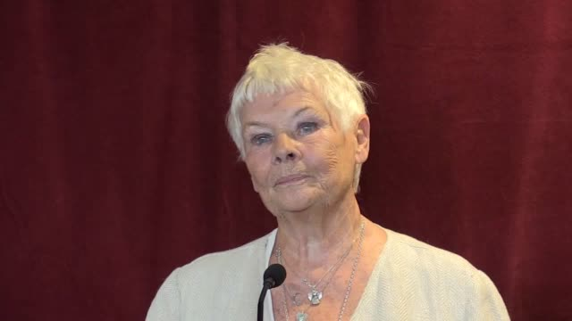 dame judi dench unveils a mural of actress dame peggy ashcroft by artist helen marshall, during the reopening of the ashcroft playhouse at the... - ジュディ・デンチ点の映像素材/bロール