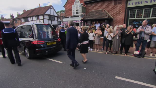 dame vera lynn's funeral cortege making its way through her home village of ditchling - grief stock videos & royalty-free footage