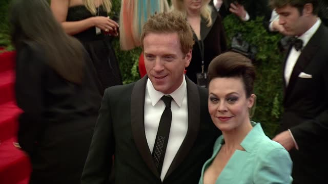 """damian lewis and helen mccrory at """"punk: chaos to couture"""" costume institute gala at metropolitan museum of art on may 06, 2013 in new york, new york - ヘレン マックローリー点の映像素材/bロール"""