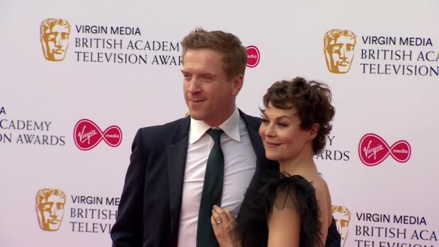 damian lewis and helen mccrory pose for photos on red carpet at bafta tv awards 2019 at royal festival hall london - two people stock videos & royalty-free footage