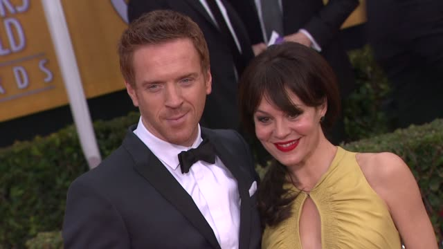 damian lewis, helen mccrory at 19th annual screen actors guild awards - arrivals on 1/27/13 in los angeles, ca . - ヘレン マックローリー点の映像素材/bロール