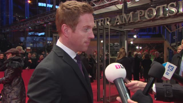 INTERVIEW Damian Lewis on visiting Berlin on Werner Herzog on set the appeal of working with him at 'Queen of the Desert' Red Carpet 65th Berlin Film...