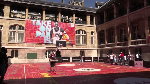 stockvideo's en b-roll-footage met damian lillard scores a basket from a roof in paris during the damian lillard academy camp presented by adidas and foot locker in paris paris, france... - blazer