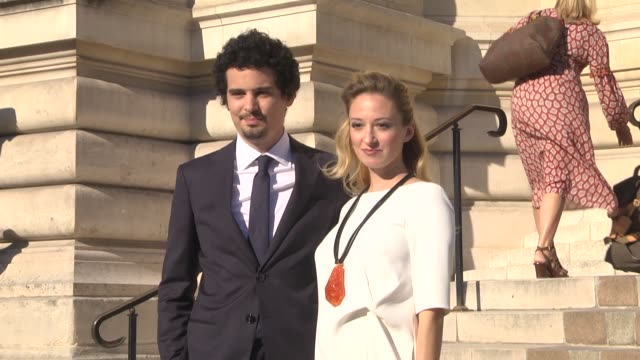 damien chazelle and olivia hamilton attend the giorgio armani prive show as part of paris fashion week haute couture fall winter 2020 on july 02 2019... - セレブリティの日常シーン点の映像素材/bロール