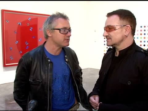 Damien Hirst and Bono on raising money for the cause and what it's all about at the Bono and Damien Hirst Paint the Town Red For Aids In Africa The...
