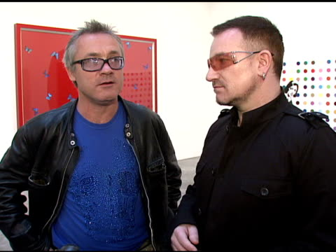 Damien Hirst and Bono on the artists making their artwork special for the cause at the Bono and Damien Hirst Paint the Town Red For Aids In Africa...