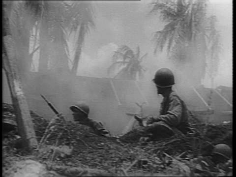 damien parer narrates over montage of marines crouched behind cover with rifles / montage of flames coming out of japanese hideouts - narrating stock videos & royalty-free footage