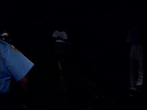 cctv footage released damilola taylor murder cctv footage released lib louisiana new orleans policeman driving car along bv policeman beckons to 4... - murder stock videos & royalty-free footage