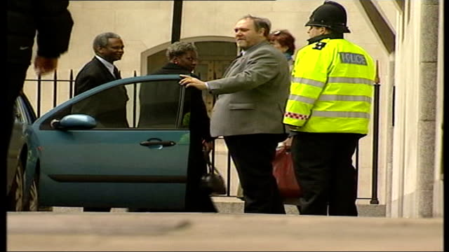 defendant takes stand **incorrect england london old bailey richard and gloria taylor along from car as arriving at court - defendant stock videos & royalty-free footage