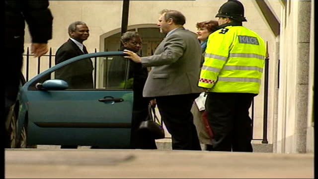defendant takes stand lms richard and gloria taylor along from car as arriving at court - defendant stock videos & royalty-free footage