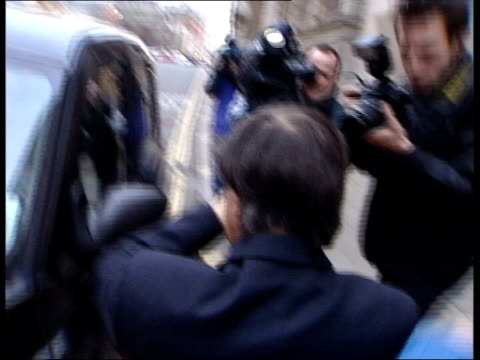 Damilola Taylor murder trial ITN MS Guillermo Casal along past into taxi as leaving court