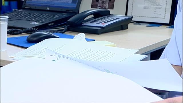 damilola taylor murder trial: ricky and danny preddie found guilty; int roz hammond looking through documents roz hammond interview sot - was blood... - großbuchstabe stock-videos und b-roll-filmmaterial