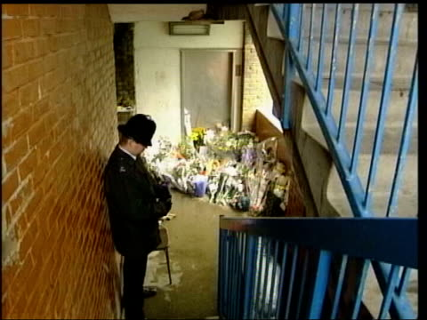 stockvideo's en b-roll-footage met two defendants found not guilty file / tx 41200 peckham floral tributes in stairwell where damilola died with police officer on duty beside file / tx... - peckham