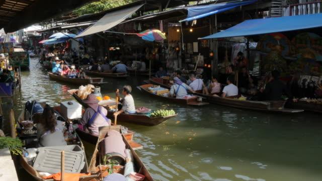 damnoen saduak floating markets, bangkok, thailand, southeast asia, asia - floating market stock videos & royalty-free footage
