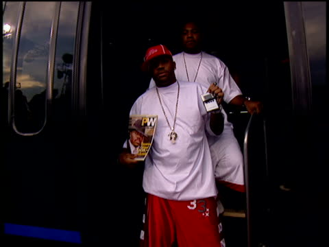 Damon Dash displaying his sneakers and walking down the 2004 MTV Video Music Awards red carpet